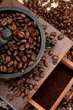 Coffe beans and grinder Stock Photography