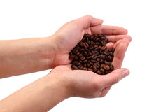 Coffe beans on the hands royalty free stock photography
