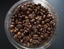 Coffe beans & jar Stock Photos