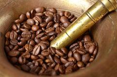 Coffe beans and mill macro shot Royalty Free Stock Photo