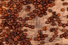 Coffe beans on old scratched table Royalty Free Stock Image