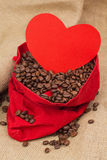 Coffe beans in red velvet sac with red heart Stock Photos