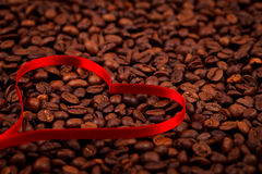 Coffe beans with ribbon heart Royalty Free Stock Photos