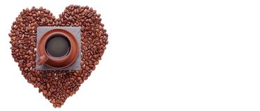 Coffe beans in the shape of a big heart, isolated on white background. Place the text. Top of view stock photo