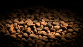 Coffe beans textured with black shine stock image