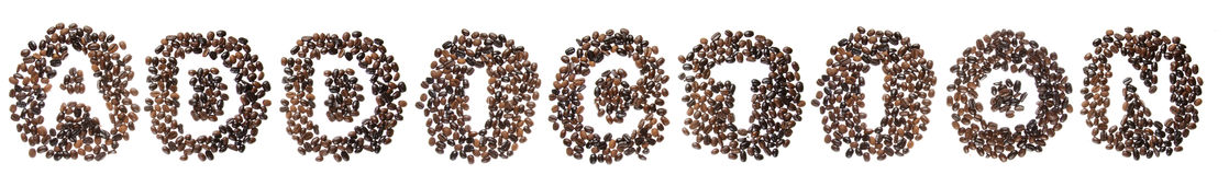 Coffe beans used to spell the word addiction Stock Photos
