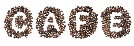 Coffe beans used to spell the word cafe Stock Photos