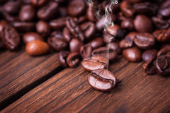 Coffe beans. On the woden table Royalty Free Stock Photo