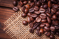 Coffe beans. On the woden table Royalty Free Stock Image