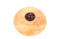 Coffe beans in a wooden cup Royalty Free Stock Photo