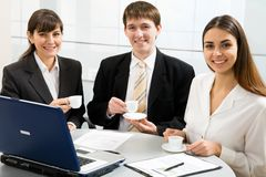Coffe break. Three smiling attractive young business people on coffe break stock photos