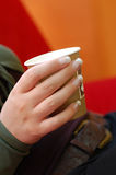 Coffe Break. Young woman with beautiful nails holding a cup of coffee to go Stock Photography