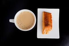 Coffe break. Cup of coffee and delicious cake on black background Royalty Free Stock Photos