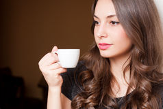 Coffe with a brunette beauty. Royalty Free Stock Image