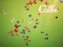 Coffe Butterflies on the wall green background colors