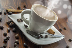 Coffe cinnamon. Hhot cup of coffee and cinnamon on wood table royalty free stock photo