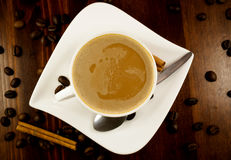 Coffe cinnamon. Hhot cup of coffee and cinnamon on wood table stock photos
