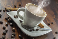 Coffe cinnamon. Hhot cup of coffee and cinnamon on wood table stock image