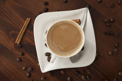 Coffe cinnamon. Hhot cup of coffee and cinnamon on wood table stock images