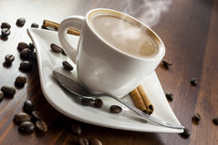 Coffe cinnamon. Hhot cup of coffee and cinnamon on wood table royalty free stock photography