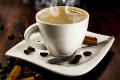 Coffe cinnamon. Hhot cup of coffee and cinnamon on wood table royalty free stock photos