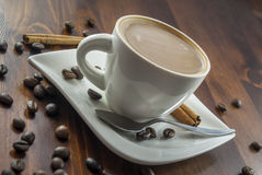 Coffe cinnamon. Hhot cup of coffee and cinnamon on wood table royalty free stock images