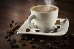 Coffe cinnamon. Hot cup of coffee and cinnamon on wood table royalty free stock photos