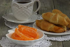 Coffe with croissants. Orange slices and croissants for breakfast Shallow DOF royalty free stock photo