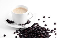 Coffe cup. With beans and spoon stock photos