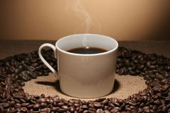 Coffe cup. Coffee cup with smoke over a gradient background stock photo
