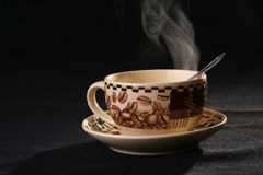 Coffe cup. Sprightliness, cheerfulness, coffee-beans, tea-party, breakfast Royalty Free Stock Photo