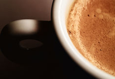 Coffe cup. A coffe cup with emphasis and light on coffee and foam royalty free stock images