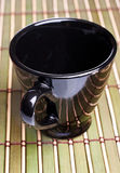 Coffe cup on bamboo mat Royalty Free Stock Photo