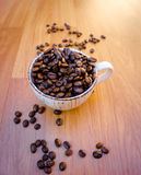 Coffe cup and bean Stock Photos