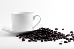 Coffe cup and beans. Coffe cup with beans on white background stock image