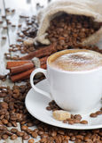 Coffe cup and beans Stock Images