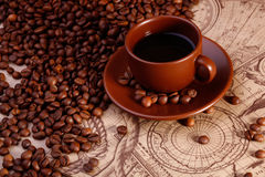 Coffe cup and beans Royalty Free Stock Photography