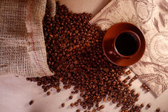 Coffe cup and beans Stock Photos