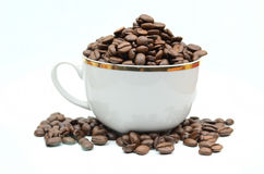 Coffe cup and beans. On white Royalty Free Stock Images