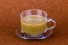 Coffe cup on brown table Royalty Free Stock Images