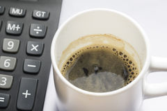 Coffe cup with Calculator closeup from Top view Royalty Free Stock Photo