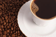 Coffe cup and coffe beans. Cup of hot black coffee with beans Stock Photos