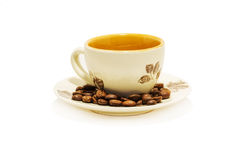 Coffe cup with coffe beans Stock Photos