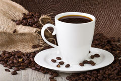 Coffe Cup with coffe beans Stock Images