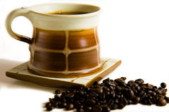 Coffe cup with coffe grains Royalty Free Stock Photo
