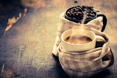 Coffe cup with coffee beans. Arabica coffee beans and cup full of coffee Royalty Free Stock Photos