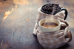 Coffe cup with coffee beans. Arabica coffee beans and cup full of coffee Stock Photos