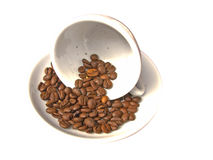 Coffe cup with coffee grains royalty free stock images