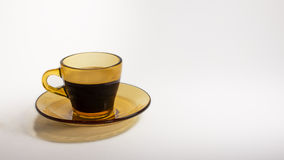 Coffee cup. Coffee in a stylish brown cup on white background Stock Photos