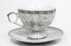 Coffe cup on a saucer. With an grey ornament Royalty Free Stock Photo